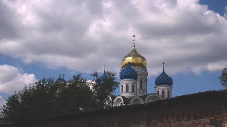 aranyozott : clouds over orthodox church, timelapse Stock mozgókép