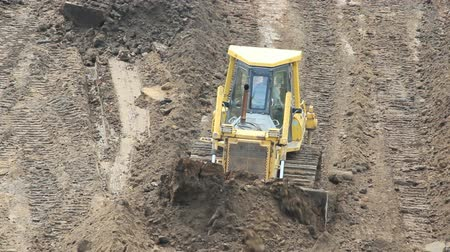 buldozer : Yellow Bulldozer Raking Clay