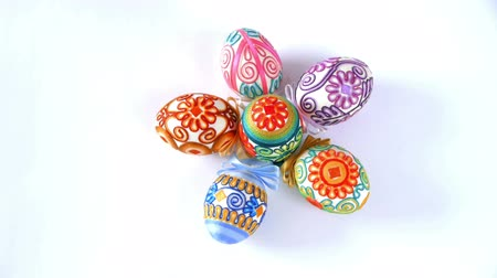 easter : Easter eggs rotating on a white background. Seamless looping.  Stock Footage