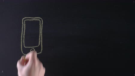 impersonal : Drawing smartphone on blackboard and arrow that points at envelope, sending messages, texting, electronic device, concept of impersonal communication. Closeup, 4K Ultra HD. Stock Footage