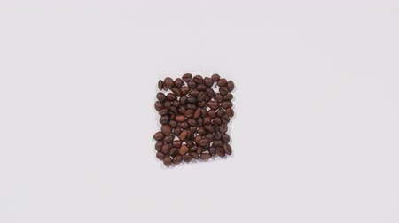 numerology : Numbers from ten to zero are made of roasted coffee beans, countdown, white surface, run out of time. Close up, stop motion, 4K Ultra HD.