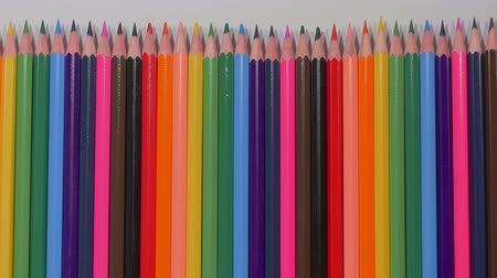 dizilirler : Set of multicolored pencils moving from right to left, sharp ends, pluralism, art, tools for expressing imagination, art. Stop motion. Close up, 4K Ultra HD.