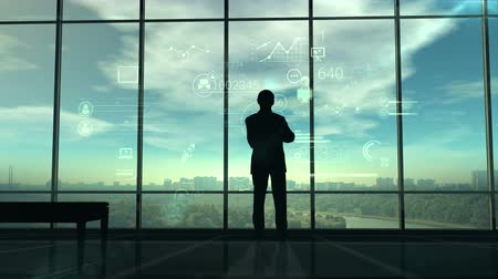 siluety : Silhouette of man and corporate infographics