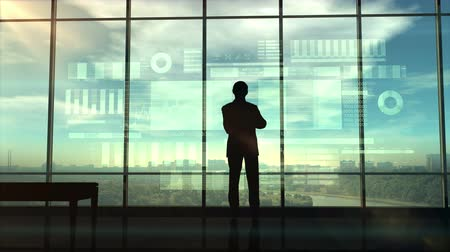 data mining : Silhouette of a trader in the office before infographics