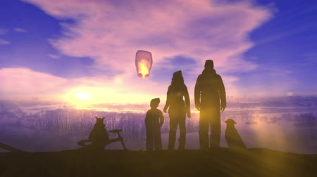A family on a winter walk launches a Chinese lantern