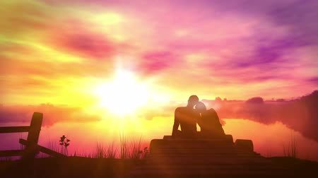 Loving couple on sunset background