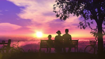 Family on a bench at sunset and a beautiful view of the river Стоковые видеозаписи