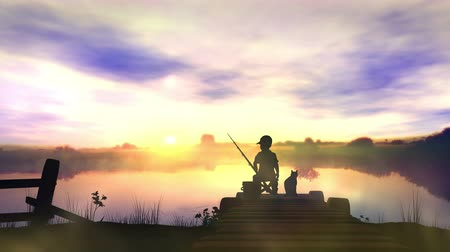 The boy is fishing at sunrise