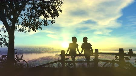 Boy and girl hold hands look at summer sunset