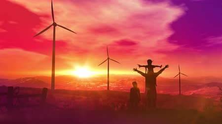 Father with children watching wind power plants