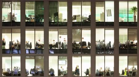 drudgery : Timelapse of the exterior of an office block at night revealing the daily activity of office workers