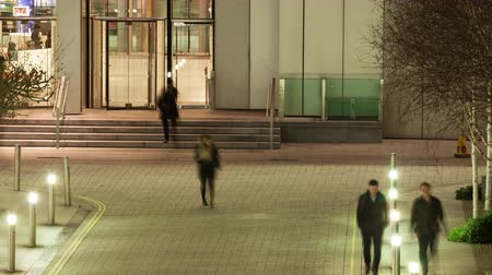 drudgery : Elevated view time lapse of workers leaving an office after dark