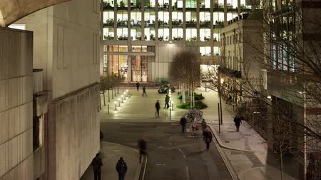 drudgery : Elevated view timelapse of a street scene showing workers leaving the office