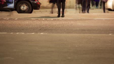 drudgery : Time-lapse of commuters legs crossing a road Stock Footage