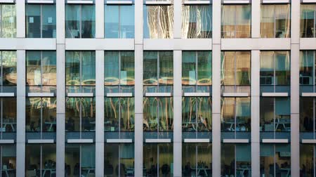 drudgery : Time lapse of the exterior of a modern office block in the afternoon showing the daily activity of office workers