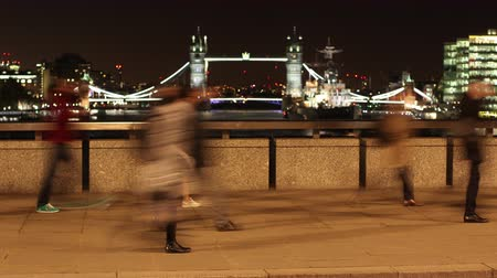 capital cities : Timelapse of commuters walking on London Bridge, Tower Bridge in the background
