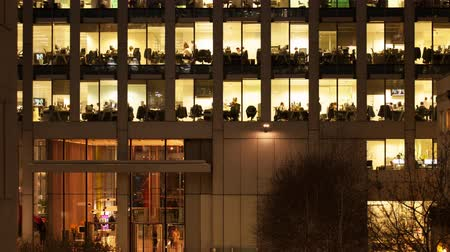 drudgery : Time-lapse of an office at night panning down to show workers leaving
