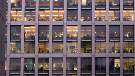 drudgery : Day to night Time-lapse of an office at night panning down