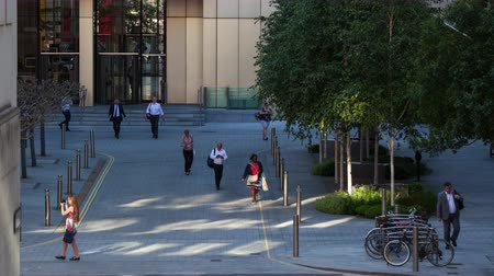 drudgery : Time-lapse of Business people leaving the office