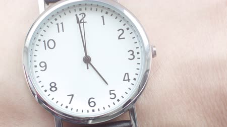 punctuality : Close up of a Caucasian man wearing a wrist watch