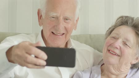 photography themes : Happy Senior Caucasian couple taking selfies on a smartphone