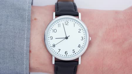 késő : Close up time-lapse of a Caucasian man wearing a wrist watch Stock mozgókép