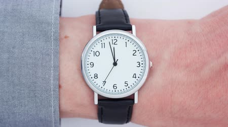 Close up time-lapse of a Caucasian man wearing a wrist watch Filmati Stock