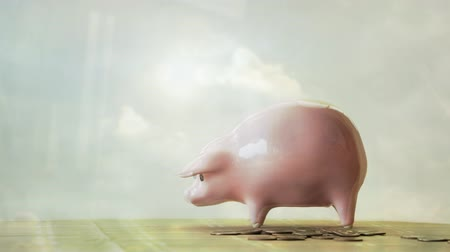 Reflection of a caucasian man putting coins into a piggy bank themes of finance saving accounts Dostupné videozáznamy