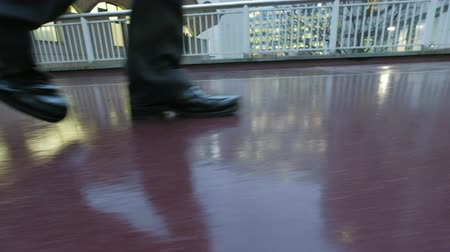 drudgery : Low angle view of a businessman walking leaving the office at dusk Stock Footage