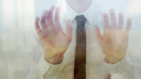 umutlu : Reflection of a caucasian businessman tapping his fingers against a window Stok Video