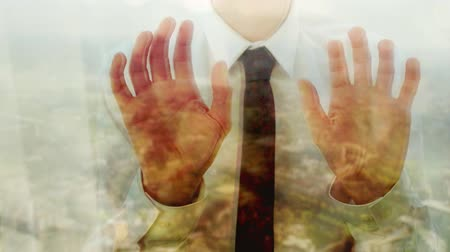 Reflection of a caucasian businessman tapping his fingers against a window Dostupné videozáznamy