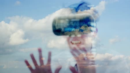 Reflection of a caucasian businessman wearing virtual reality goggles with a plain sky behind themes of technology game virtual vr 360 Dostupné videozáznamy