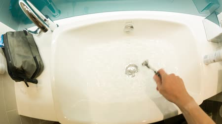 shaving foam : Personal perspective of a Caucasian man shaving in a hotel bathroom