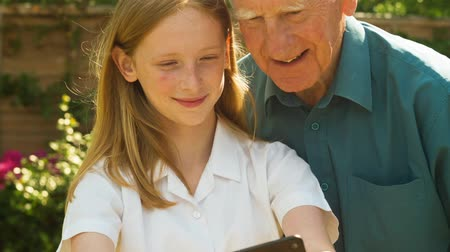 self portrait photography : Senior man and his Grand Daughter taking selfies on a smartphone