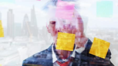 dopisní papír : Reflection of a creative breative businessman brainstorming ideas putting  notes on to a window London skyline behind