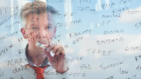 キーワード : Reflection of a creative businessman brainstorming writing business keywords onto glass