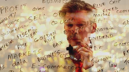 anahtar kelime : Reflection of a creative businessman brainstorming writing business keywords onto glass at night