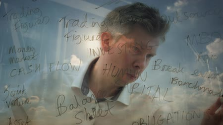 anahtar kelime : Reflection of a creative businessman brainstorming planning a solution writing business words onto glass