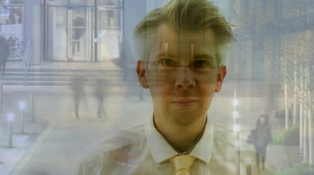кавказский : Composite - Realtime reflection of a businessman looking at time-lapse people leaving the office