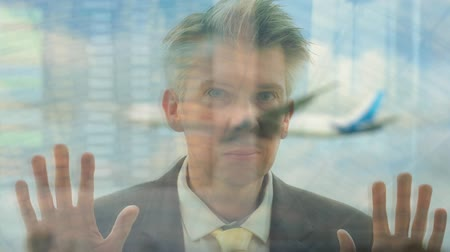 去る : Reflection of a caucasian business traveller looking out of an airport window