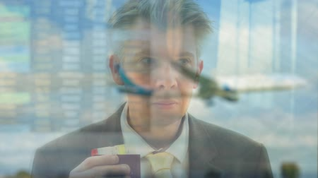urlop : Reflection of a caucasian business traveller looking out of an airport window