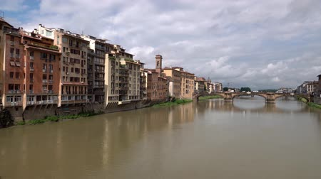 olasz kultúra : Cityscape with old buildings, Ponte alla Carraia bridge and Arno River in Florence, Tuscany, Italy