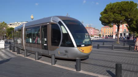 cote : City tram turns from Massena Square to the Boulevard Jean Jaures in Nice, France Stock Footage