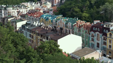 gora : Panorama of Vozdvizhenska and Honcharna street in the Podol district in Kiev city. Old town, Capital of Ukraine - Kyiv in summer evening Stock Footage