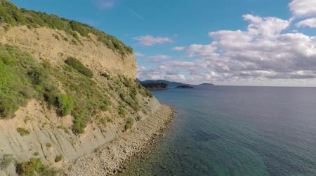 tarde : Drone footage flying along coastline passing by cliffs in Messinia - Greece