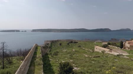 markolat : Handheld panoramic view of islands and a dead forest from inside of castle Stock mozgókép