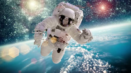 gerçeküstü : Astronaut in outer space against the backdrop of the planet earth. Elements of this image furnished by NASA. Stok Video
