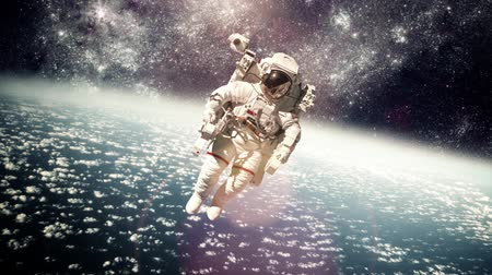 astronauta : Astronaut in outer space against the backdrop of the planet earth. Elements of this image furnished by NASA. Vídeos