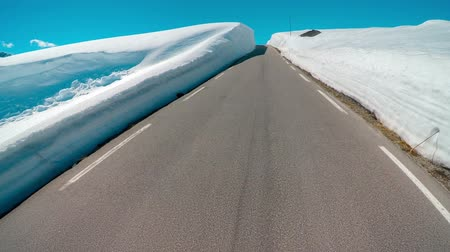 rota : Mountain road in Norway with high snow wall