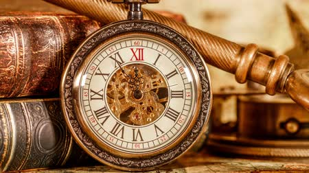 hora : Vintage Antique pocket watch on the background of old books